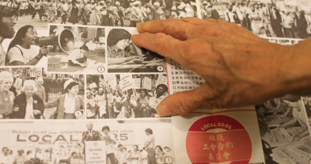 The hand of Mei Yin Tsang points to a grid of black-and-white images of protesters and activists. Several photos feature East Asian women. In one photo, a group of Black women hold placards.