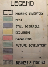 "A map from 1938 of Brooklyn, NY appears alongside a legend that designates various colors as indicative of types of neighborhoods. The main colors on the map are blue (which indicates a neighborhood that is ""still desirable""; yellow (""declining""); and pink (""hazardous"")."